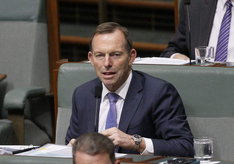 FILE - In this Monday, Aug. 20, 2018 file photo, former Australian Prime Minister Tony Abbott listens to lawmakers speak in Parliament in Canberra, Australia. Prominent equality and environmental activists, including Lord of the Rings star Ian McKellen have urged the British government to drop plans to make former Australian Prime Minister Tony Abbott a U.K. trade advisor. Prime Minister Boris Johnsons government faced growing opposition Friday, Sept. 4, 2020 over reports it will appoint Abbott, who led a conservative Australian government between 2013 and 2015, to the U.K.s Board of Trade. (AP Photo/Rod McGuirk, file)