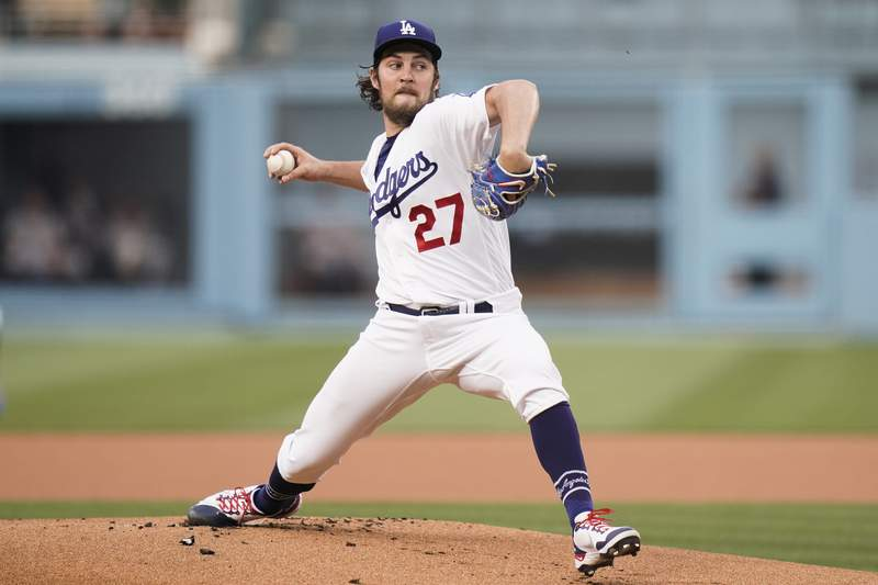 Los Angeles Dodgers starting pitcher Trevor Bauer throws against the San Francisco Giants during the first inning of a baseball game, Monday, June 28, 2021, in Los Angeles. (AP Photo/Jae C. Hong)