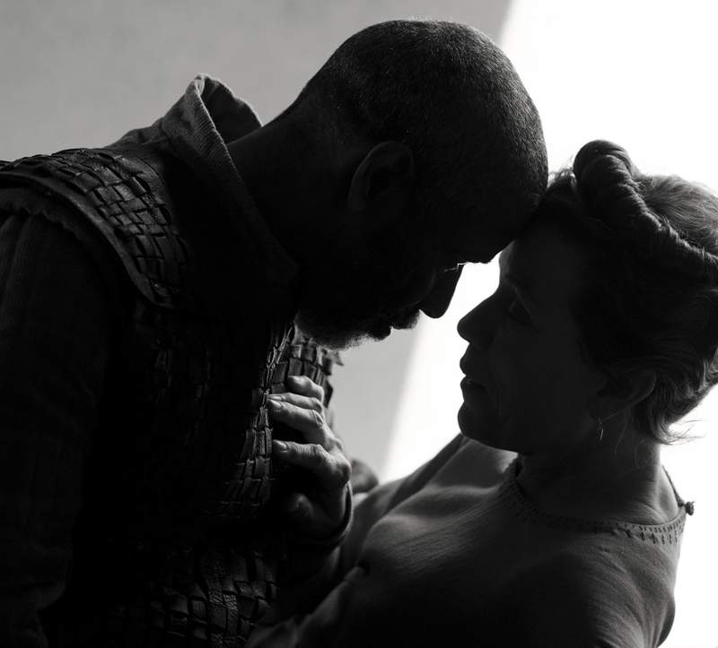 This image released by Apple shows Denzel Washington, left, and Frances McDormand in a scene from The Tragedy of Macbeth, premiering at the New York Film Festival. (Alison Rosa/Apple via AP)
