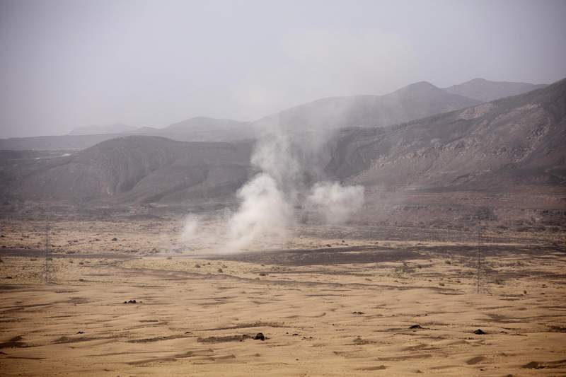 Smoke rises from a Houthi missile attack near the Kassara frontline during clashes with Yemeni fighters backed by the Saudi-led coalition, in Marib, Yemen, Sunday, June 20, 2021. (AP Photo/Nariman El-Mofty)