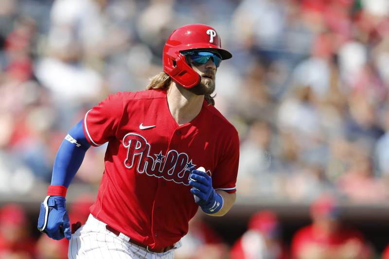 File photo- Philadelphia Phillies' Bryce Harper rounds first base after his two-run home run during the first inning of a spring training baseball game against the Pittsburgh Pirates, Wednesday, March 4, 2020, in Clearwater, Fla. (AP Photo/Carlos Osorio)
