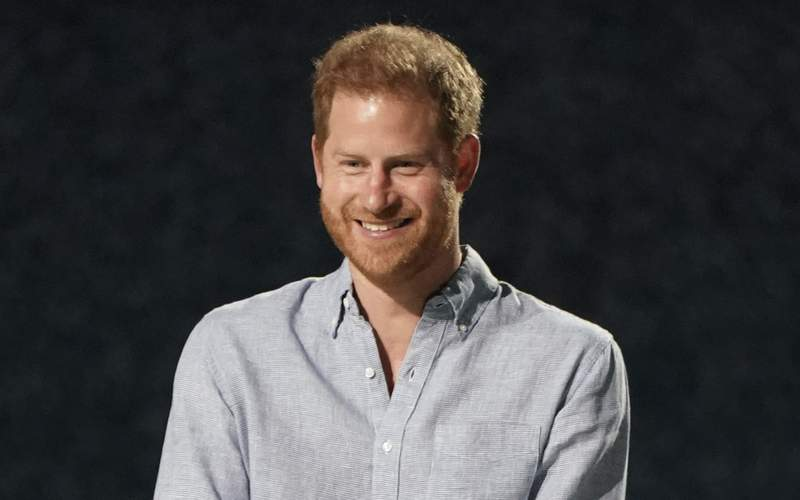"""FILE - Prince Harry, Duke of Sussex, speaks at """"Vax Live: The Concert to Reunite the World"""" on May 2, 2021, in Inglewood, Calif. Harry is writing what his publisher is calling an intimate and heartfelt memoir. Random House announced on Monday, July 19, 2021, that the book, currently untitled, is expected to come out late in 2022.  (Photo by Jordan Strauss/Invision/AP, File)"""