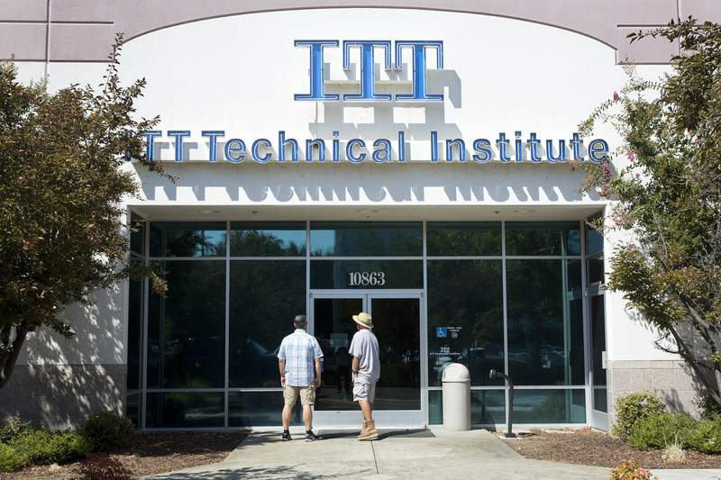 FILE - In this Sept. 6, 2016, file photo students find the doors locked to the ITT Technical Institute campus in Rancho Cordova, Calif. The U.S. Education Department announced Thursday, Aug. 26, 2021, it will forgive student debt for more than 100,000 borrowers who attended the now-defunct ITT Technical Institute chain but left before graduating. (AP Photo/Rich Pedroncelli, File)