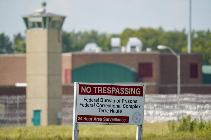 FILE - This Aug. 26, 2020 file photo shows the federal prison complex in Terre Haute, Ind. Inmates on federal death row tell The Associated Press that a leading topic of conversation through airducts they use to communicate is whether President Joe Biden will keep a campaign pledge to halt federal executions. Biden hasnt spoken publicly to that question since taking office four days after the Trump administration executed the last of 13 inmates at the Terre Haute prison where federal death row is located. (AP Photo/Michael Conroy, File)