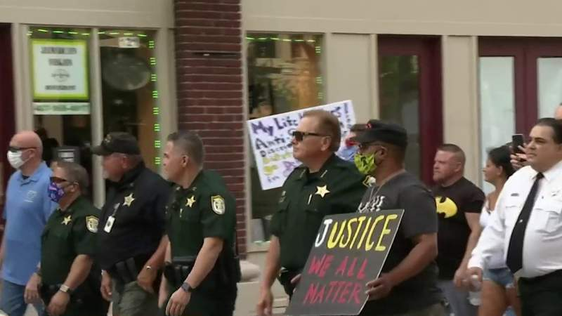 Police join protesters in March for Justice in Kissimmee