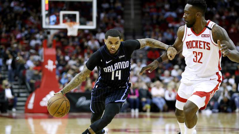D.J. Augustin #14 of the Orlando Magic drives to the basket while defended by Jeff Green #32 of the Houston Rockets. (Photo by Tim Warner).