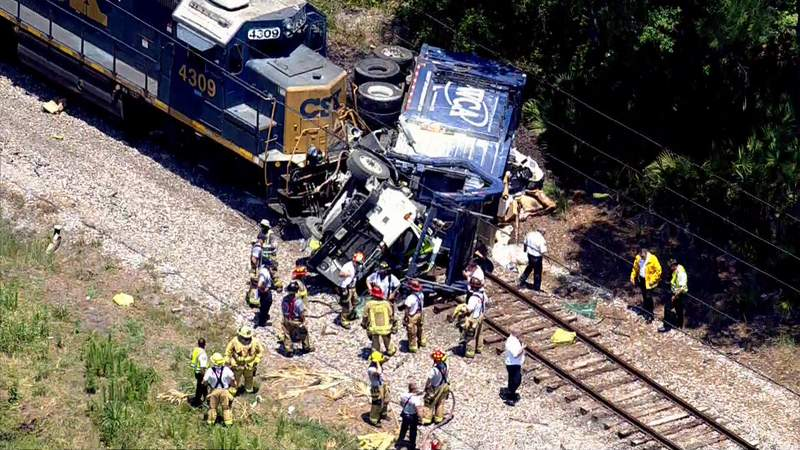 A CSX train crashed into a dump truck in Seminole County, the FHP says.