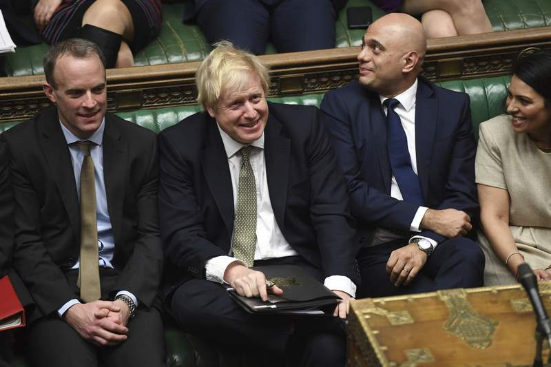 In this photo made available by the UK Parliament, Britain's Prime Minister Boris Johnson, center, attends the debate in the House of Commons, London, Thursday Dec. 19, 2019. Boris Johnson signaled an end to Britains era of Brexit deadlock Thursday, announcing a packed legislative program intended to take the U.K. out of the European Union on Jan. 31, overhaul everything from fishing to financial services and shore up the countrys cash-starved public services. (Jessica Taylor/UK Parliament via AP)