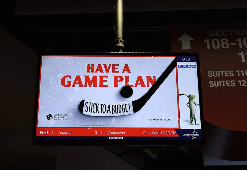 """An ad for the American Gaming Association is seen tested on a screen after an NHL hockey game between the Washington Capitals and the Philadelphia Flyers, Wednesday, March 4, 2020, in Washington. The gambling industry is launching a campaign to urge sports bettors to wager responsibly, including setting and sticking to a budget, and learning thoroughly about anything on which they make a bet. The gaming association on Thursday launched its """"Have A Game Plan"""" campaign in hockey arenas in Washington and Las Vegas. (AP Photo/Nick Wass)"""