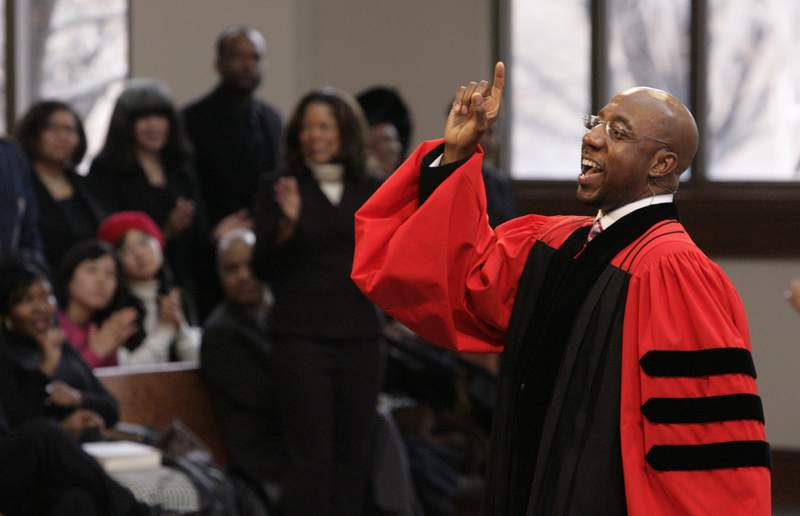 FILE - In this Sunday Jan. 18, 2009 file photo, Rev. Raphael Warnock delivers a sermon during a church service at Ebenezer Baptist Church in Atlanta. Warnock is senior pastor at Ebenezer, the church where the late Dr. Martin Luther King once also pastored. (AP Photo/John Amis)