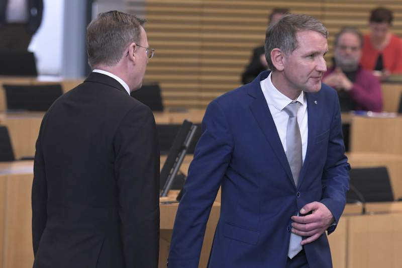 Bjoern Hoecke, right, candidate of the far-right Alternative fuer Deutschland, AfD, party for the state governor in German state Thuringia walks way from new elected state governor of the German state Bodo Ramelow, left, of the Left party after the governor elections at the state parliament in Erfurt, Germany, Wednesday, March 4, 2020. (AP Photo/Jens Meyer)