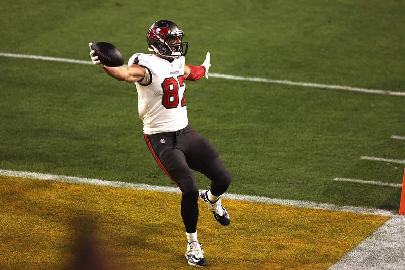 Tampa Bay Buccaneers' Rob Gronkowski reacts as he scores a touchdown during the first half of the NFL Super Bowl 55 football game against the Kansas City Chiefs, Sunday, Feb. 7, 2021, in Tampa, Fla. (AP Photo/Mark LoMoglio)