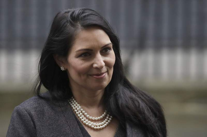 """FILE - In this file dated Thursday, Feb. 13, 2020, British Home Secretary lawmaker Priti Patel, leaves 10 Downing Street in London.  Priti Patel has said in a statement Tuesday Nov. 3, 2020, that Britain has escalated the UK terror threat level to """"severe"""" as a """"precautionary measure"""", warning that a terror attack is highly likely following a terror attack on Monday in Vienna, Austria.  (AP Photo/Matt Dunham, File)"""