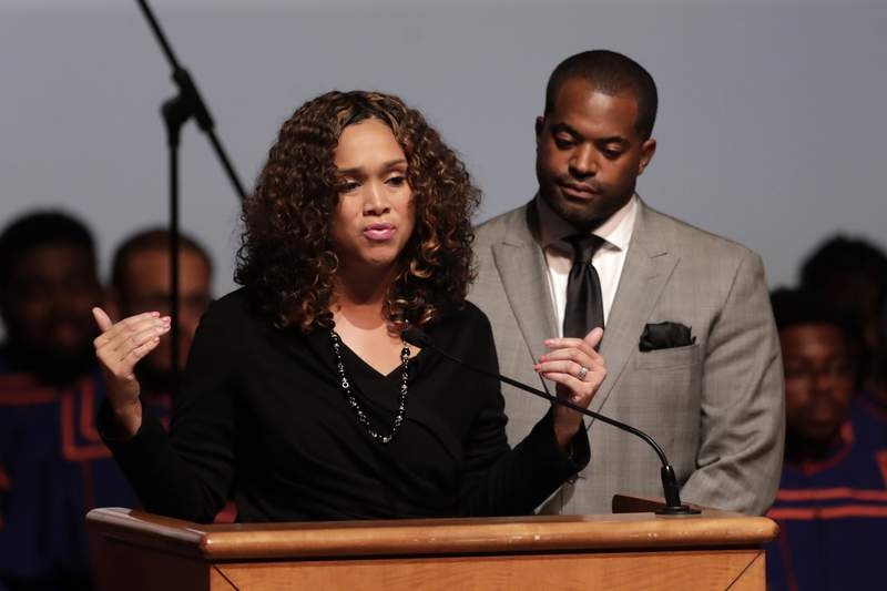 FILE - In this Wednesday, Oct. 23, 2019 file photo, Maryland State Attorney Marilyn Mosby, left, speaks while standing next to her husband, Maryland Assemblyman Nick Mosby, during a viewing service for the late U.S. Rep. Elijah Cummings at Morgan State University in Baltimore.  Federal prosecutors have launched a criminal investigation into the finances of Baltimores top prosecutor and her husband, who is city council president. The Baltimore Sun reported Friday, March 19, 2021 that it obtained a grand jury subpoena seeking business records for States Attorney Marilyn Mosby and City Council President Nick Mosby, including tax returns, bank and credit card statements and other  documents. (AP Photo/Julio Cortez, File)