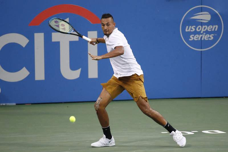 FILE - In this Saturday, Aug. 3, 2019, file photo, Nick Kyrgios, of Australia, returns the ball to Stefanos Tsitsipas, of Greece, during a semifinal at the Citi Open tennis tournament in Washington. The tournament that was supposed to mark the official return of mens professional tennis amid the coronavirus pandemic has been canceled. The Citi Open in Washington, scheduled to start with Aug. 13 qualifying, was called off Tuesday, July 21, 2020, because of what tournament manager Mark Ein said are too many unresolved external issues, including various international travel restrictions as well as troubling health and safety trends.(AP Photo/Patrick Semansky, File)