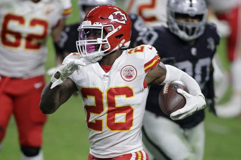 FILE - In this Nov. 22, 2020, file photo, Kansas City Chiefs running back Le'Veon Bell (26) carries the ball against the Las Vegas Raiders during the first half of an NFL football game in Las Vegas. The Baltimore Ravens signed Bell to their practice squad, adding another backfield option in the aftermath of J.K. Dobbins season-ending injury. Bell was cut early last season by the New York Jets, then rushed for 328 yards in 11 games with Kansas City. He did not play in the Super Bowl for the Chiefs. (AP Photo/Isaac Brekken, File)