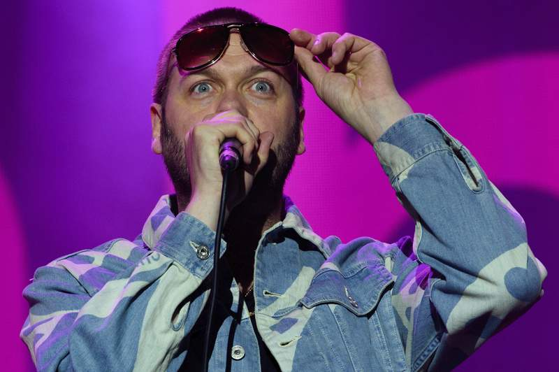 FILE - In this Saturday, Aug. 22, 2015 file photo, Tom Meighan from British band, Kasabian performs on stage during V Festival 2015 at Hylands Park in Chelmsford, Essex, England. British rockers Kasabian said in a statement Monday July 6, 2020, that frontman Tom Meighan has left the band to deal with personal issues. (Photo by Jonathan Short/Invision/AP, File)