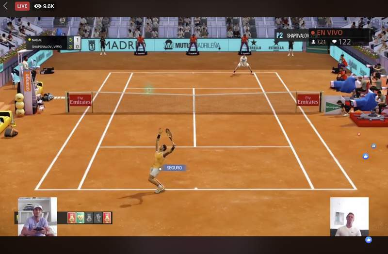"""A screen grab taken on Monday April 27, 2020 showing Spain's Rafael Nadal, bottom left, playing against Canada's Denis Shapovalov, bottom right, in a """"virtual"""" tennis match at a tournament hosted by the Madrid Open. Tennis has joined the video game craze taking over the sports world during the coronavirus pandemic, with Rafael Nadal, Andy Murray and 30 other pros trading in their rackets for controllers this week to participate in a """"virtual"""" tournament hosted by the Madrid Open. (Mutua Madrid Open via AP)"""