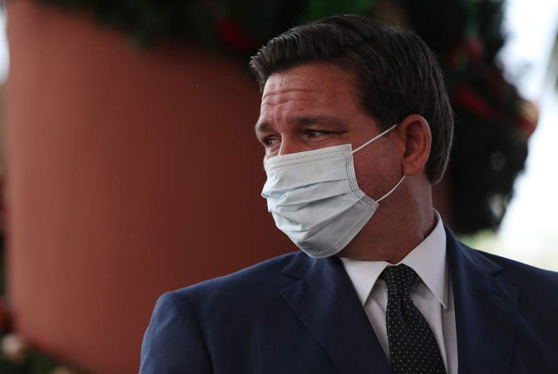 Florida Gov. Ron DeSantis attends a press conference where he spoke about the Pfizer-BioNtech COVID-19 vaccine at the John Knox Village Continuing Care Retirement Community on December 16, 2020 in Pompano Beach, Florida. The facility, one of the first in the country to do so, vaccinated approximately 170 people including healthcare workers and elder care people.  (Photo by Joe Raedle/Getty Images)