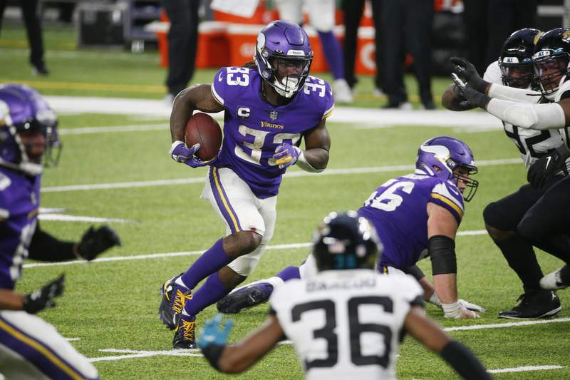 Minnesota Vikings running back Dalvin Cook (33) runs up field during overtime in an NFL football game against the Jacksonville Jaguars, Sunday, Dec. 6, 2020, in Minneapolis. The Vikings won 27-24. (AP Photo/Bruce Kluckhohn)