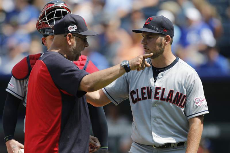 FILE - In a Sunday, July 28, 2019 file photo, Cleveland Indians manager Terry Francona, left, has words with pitcherTrevor Bauer, right, as Bauer is taken out in the fifth inning of a baseball game against the Kansas City Royals at Kauffman Stadium in Kansas City, Mo. Francona said Sunday, July 5, 2020 that he believes the Indians need to change their name. I think it's time to move forward, Francona said Sunday. (AP Photo/Colin E. Braley, File)