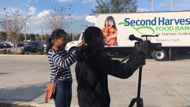 Middle school students shoot a video for Second Harvest Food Bank of Central Florida, one of 10 nonprofits getting some help from local students and The Victory Cup Initiative.