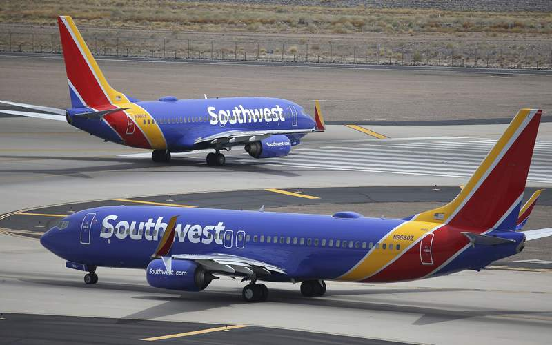 FILE - This Wednesday, July 17, 2019 file photo shows Southwest Airlines planes at Phoenix Sky Harbor International Airport in Phoenix. The Transportation Department's inspector general said in a report Tuesday, Feb. 11, 2020 that Southwest Airlines continues to fly airplanes with safety concerns, putting 17 million passengers at risk, while federal officials do a poor job overseeing the airline. (AP Photo/Ross D. Franklin, File)
