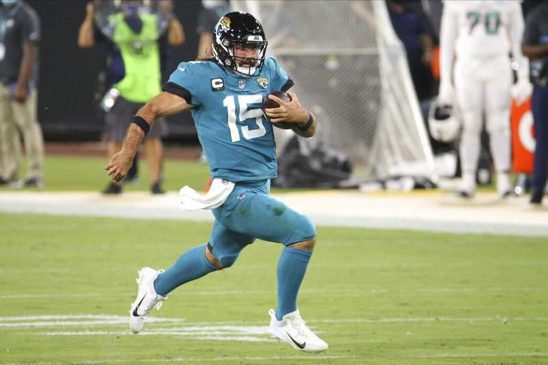 Jacksonville Jaguars quarterback Gardner Minshew scrambles for yardage against the Miami Dolphins during the first half of an NFL football game, Thursday, Sept. 24, 2020, in Jacksonville, Fla. (AP Photo/Stephen B. Morton)