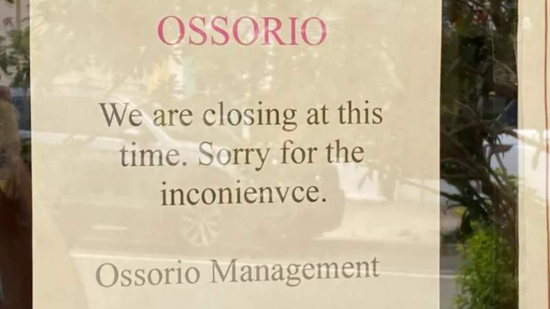 Sign posted on the door of Ossorio Cafe & Bakery in Cocoa Village