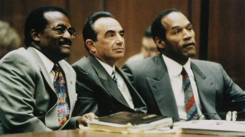 (from left) Johnnie Cochran, Robert Shapiro and O.J. Simpson. Photo by Ted Soqui/Sygma