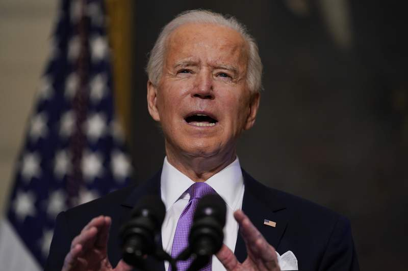 President Joe Biden delivers remarks on COVID-19, in the State Dining Room of the White House, Tuesday, Jan. 26, 2021, in Washington. (AP Photo/Evan Vucci)