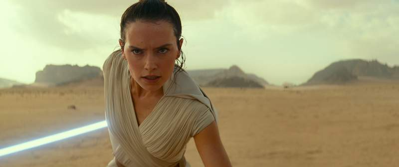 """This image released by Disney/Lucasfilm shows Daisy Ridley as Rey in a scene from """"Star Wars: The Rise of Skywalker."""" The film will begin streaming on Disney Plus on May 4, about two months earlier than scheduled. (Disney/Lucasfilm Ltd. via AP)"""