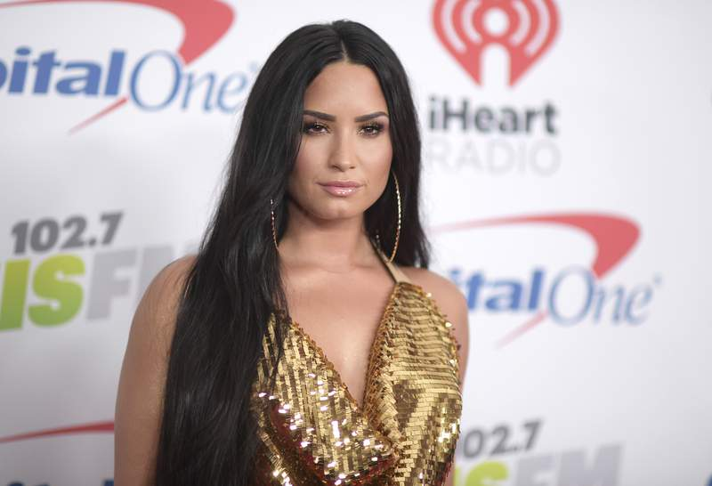 FILE - In this Dec. 1, 2017 file photo, Demi Lovato arrives at Jingle Ball at The Forum in Inglewood, Calif. Lovato will perform the National Anthem at Super Bowl. NFL and Fox on Thursday, Jan. 16, 2020 announced the performance, which will take place ahead of the big game on Feb. 2 at Hard Rock Stadium in Miami. Jennifer Lopez and Shakira will headline the halftime show. (Photo by Richard Shotwell/Invision/AP, File)