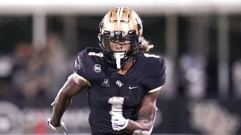 Central Florida wide receiver Jaylon Robinson runs a pass pattern against Cincinnati during the second half of an NCAA college football game, Saturday, Nov. 21, 2020, in Orlando, Fla. (AP Photo/John Raoux)