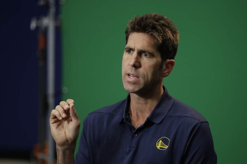 FILE - In this Sept. 30, 2019, file photo, Golden State Warriors general manager Bob Myers gestures during the NBA basketball team's media day in San Francisco. Myers hears the chatter about everything riding on Golden State's draft pick at second overall. About all the pressure on his shoulders to find just the right player to join Stephen Curry and Klay Thompson, regular All-Stars Draymond Green and Andrew Wiggins. Someone who will make an instant impact and immediately help the Warriors return to contention and respectability following a last-place finish. (AP Photo/Ben Margot, File)