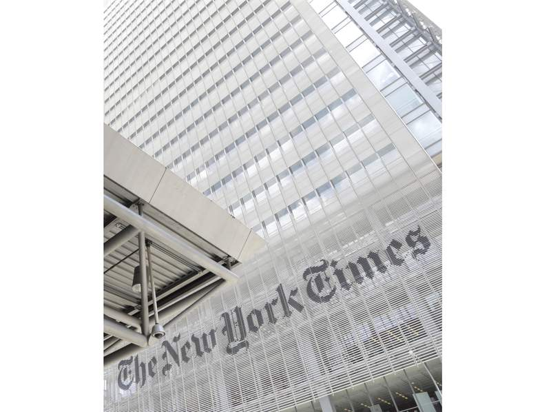 FILE - This June 22, 2019 file photo shows the exterior of the New York Times building in New York. News organizations across the United States are lifting paywalls to share coverage of the coronavirus pandemic, a public service many hope will convince more readers to eventually become paying customers. Media outlets big and small, from The New York Times to the Telegraph-Forum in Bucyrus, Ohio, are letting people read their coronavirus coverage without a subscription. (AP Photo/Julio Cortez, File)