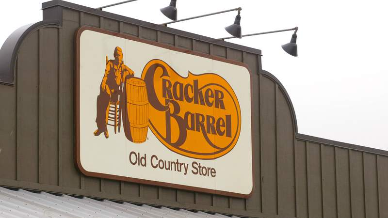 A Cracker Barrel Old Country Store sign is visible atop one of its restaurant stores April 12, 2002 in Naperville, IL.