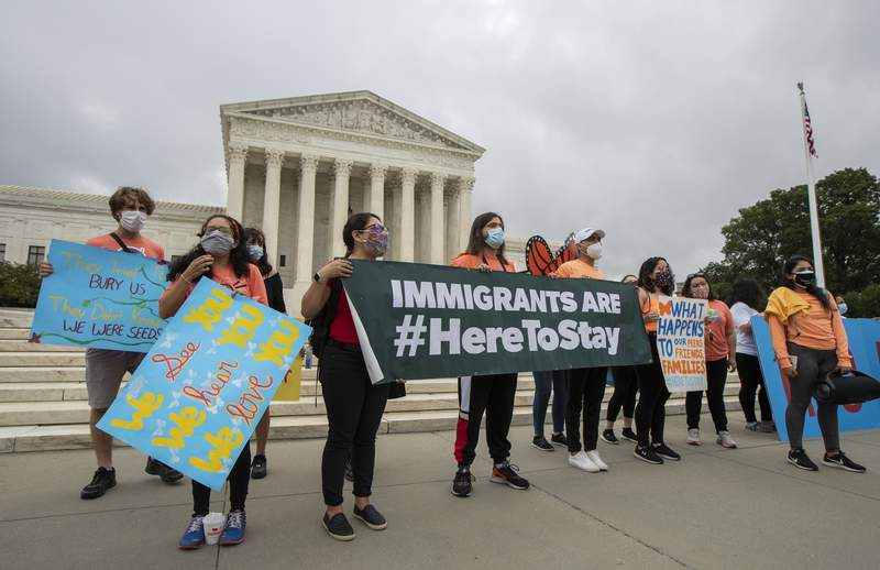 In this June 18, 2020, photo, Deferred Action for Childhood Arrivals (DACA) students celebrate in front of the Supreme Court after the Supreme Court rejected President Donald Trump's effort to end legal protections for young immigrants in Washington. Less than five months from Election Day, President Donald Trump is positioning himself as the spokesman for voters resisting a new wave of cultural change, ready to ride any backlash from the protests calling for racial equality and police reform and this weeks Supreme Court rulings extending protections to gay workers and young immigrants. (AP Photo/Manuel Balce Ceneta)