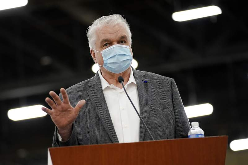 FILE - In this April 29, 2021, file photo, Nevada Gov. Steve Sisolak speaks during a news conference in Las Vegas. Gov. Sisolak applauded Nevada lawmakers for passing hundreds of bills in a legislative session colored heavily by the coronavirus pandemic. In an interview with reporters Tuesday, June 1, 2021, Sisolak said he felt optimistic about the state's future. (AP Photo/John Locher, File)