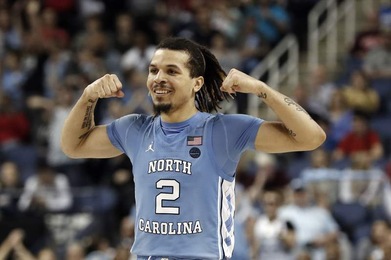 FILE - North Carolina guard Cole Anthony (2) reacts during the second half of an NCAA college basketball game against Virginia Tech at the Atlantic Coast Conference tournament in Greensboro, N.C., in this Tuesday, March 10, 2020, file photo. Anthony is a possible pick in the NBA Draft, Wednesday, Nov. 18, 2020. (AP Photo/Gerry Broome, File)