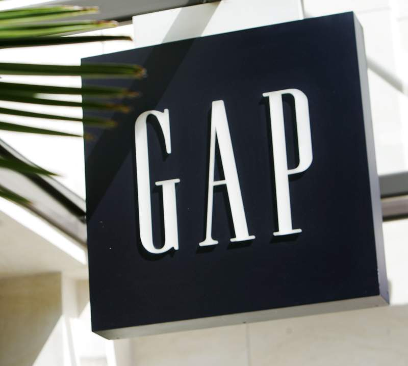 FILE - In this Thursday, April 12, 2007 file photo, A sign at a Gap store is seen in The Grove shopping area in Los Angeles. A dozen retailers including Gap and H&M are collaborating on a campaign this fall to enlist customers to combat bad behavior against retail workers. The campaign is being spearheaded by Open to All and two other groups, and comes as workers face increased harassment as they try to enforce social distancing and mask protocols during the pandemic.  (AP Photo/Reed Saxon, File)