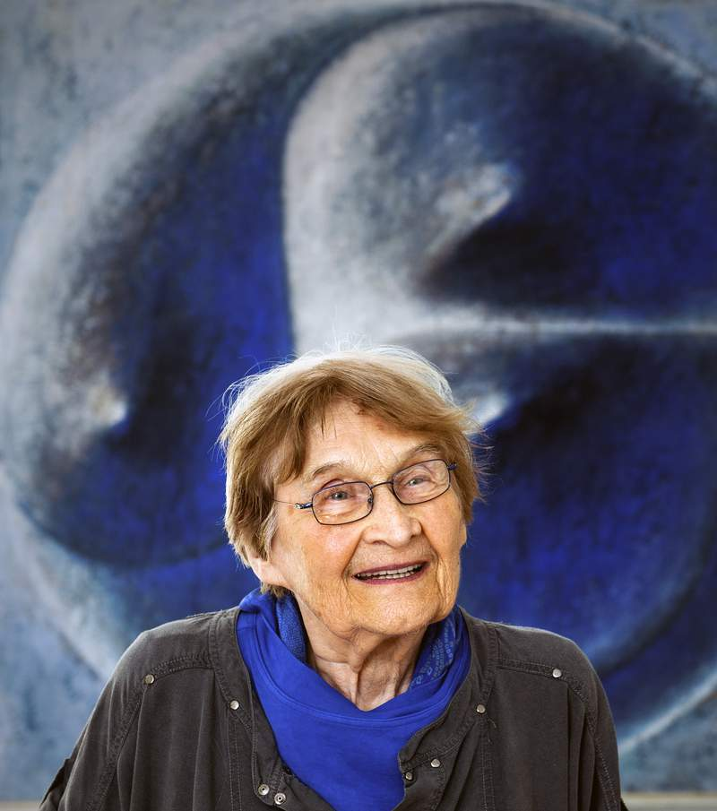 FILE - In this July 14, 2014 file photo, influential Czech glass artist Jaroslava Brychtova smiles in Zelezny Brod, Czech Republic. Brychtova, a Czech glass artist whose sculptures and objects created together with her late husband Stanislav Libensky gained recognition worldwide has died. She was 95. Brychtova died on Wednesday, April 8, 2020 in a hospital In Jablonec nad Nisou, sculpturer Pavel Karous who assisted her on one of her last glass works said on Facebook.(Radek Petrasek/CTK via AP, file)