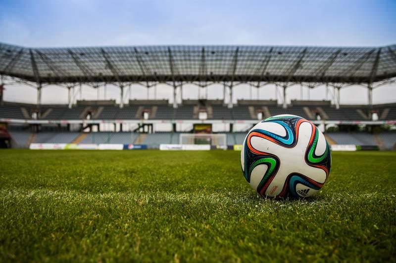 A soccer ball in an open stadium