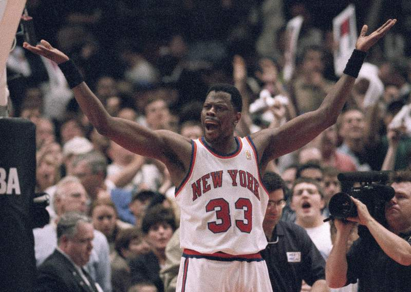 FILE - New York Knicks' Patrick Ewing encourages fans to cheer in the final seconds of their playoff game against the Charlotte Hornets in New York, in this Saturday, April 26, 1997, file photo. The Knicks won 100-93. Patrick Ewing and Georgetown are back in the NCAA Tournament. The 7-footer who helped the Hoyas win one national championship and reach two other finals in the 1980s is now coaching at his alma mater. Georgetown is a No. 12 seed and will play No. 5 Colorado in the East Region on Saturday. (AP Photo/Adam Nadel, File)