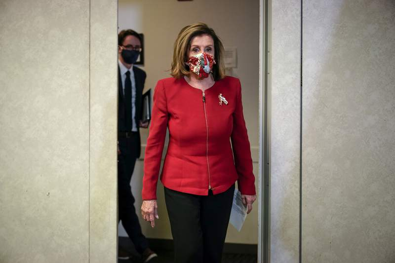 Speaker of the House Nancy Pelosi, D-Calif., arrives to talk to reporters about Election Day results in races for the House of Representatives, at Democratic National Committee headquarters in Washington, Tuesday, Nov. 3, 2020. (AP Photo/J. Scott Applewhite, Pool)