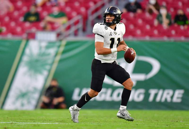 TAMPA, FLORIDA - NOVEMBER 27: Dillon Gabriel #11 of the UCF Knights looks to pass the ball during the second quarter against the South Florida Bulls at Raymond James Stadium on November 27, 2020 in Tampa, Florida. (Photo by Julio Aguilar/Getty Images)