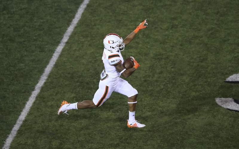 Jaylan Knighton of the Miami Hurricanes runs for a touchdown in the third quarter against the Louisville Cardinals at Cardinal Stadium on September 19, 2020 in Louisville, Kentucky.