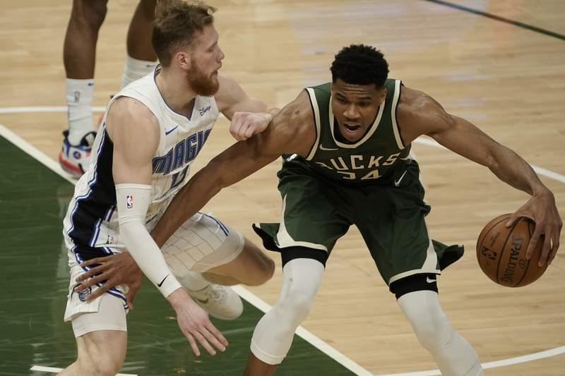Milwaukee Bucks' Giannis Antetokounmpo tries to drive past Orlando Magic's Ignas Brazdeikis during the first half of an NBA basketball game Tuesday, May 11, 2021, in Milwaukee. (AP Photo/Morry Gash)
