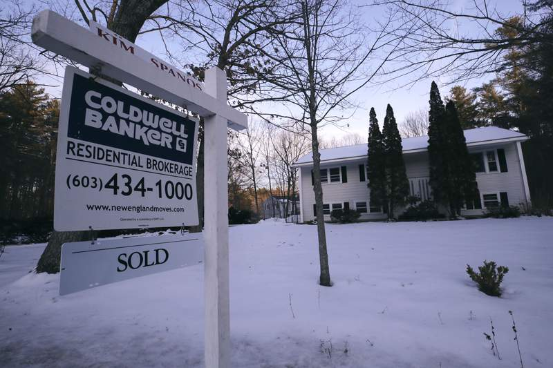 FILE - This Jan. 9, 2020, file photo shows a sold sign is posted on a real estate sign outside a home in Derry, N.H.  On Thursday, March 5, U.S. long-term mortgage rates dropped to all-time lows this week as anxiety over risks to the economy deepened amid the burgeoning viral outbreak crisis. Mortgage buyer Freddie Mac says the average rate on the benchmark 30-year loan plummeted to 3.29% from 3.45% last week.  (AP Photo/Charles Krupa, File)