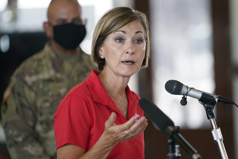 FILE - In this Friday, Aug. 14, 2020, file photo, Iowa Gov. Kim Reynolds speaks during a news conference, in Cedar Rapids, Iowa. The coronavirus is getting worse in states that President Donald Trump needs the most. (AP Photo/Charlie Neibergall, File)